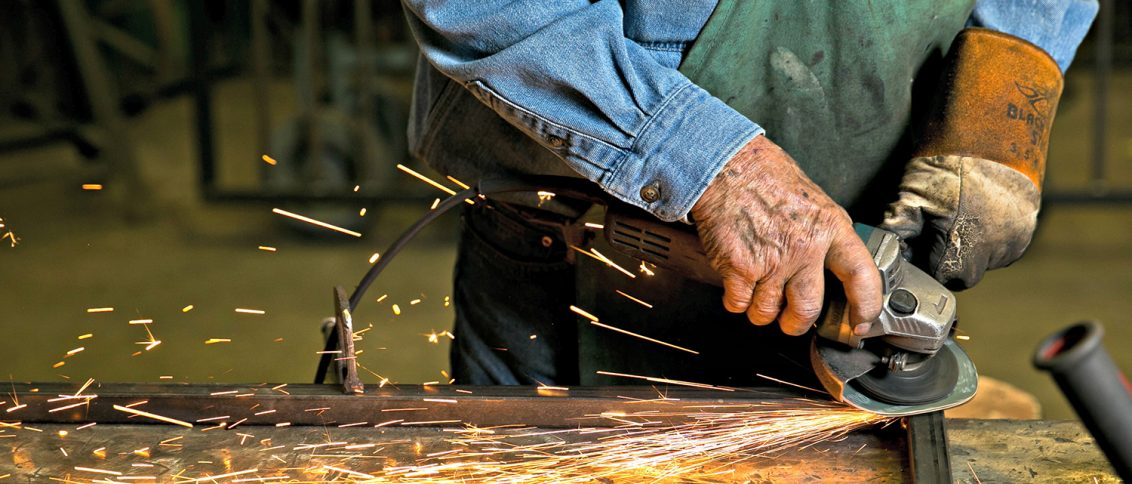 Don Devol Sr. works on a custom metal project at Devol's Custom Iron in Lebanon, IN, Monday, June 1st, 2015.