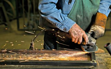 Don Devol Sr. works on a custom metal project at Devol's Custom Iron in Lebanon, IN, Monday, June 1st, 2015.